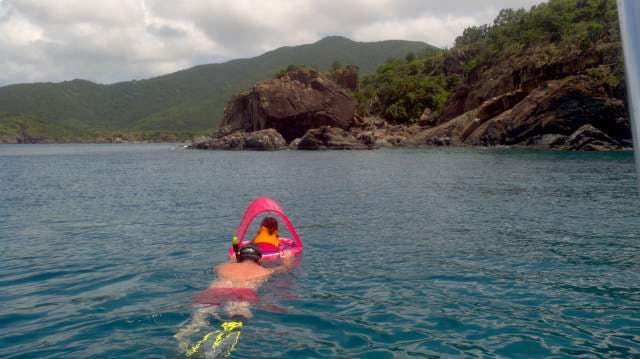 Capt.-Chad-taking-his-daughter-snorkeling-into-a-cave-at-Lamshur-Bay-St.-John.